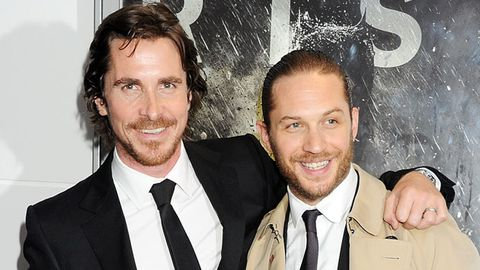 Christian Bale and Tom Hardy hit the red carpet for Dark Knight Rises. Image: Getty