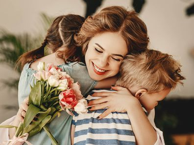Children give their mother flowers on Mother's Day