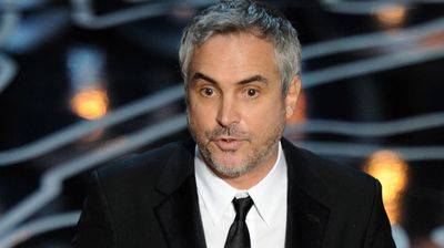 Director Alfonso Cuaron accepts the Best Achievement in Directing award for 'Gravity'.