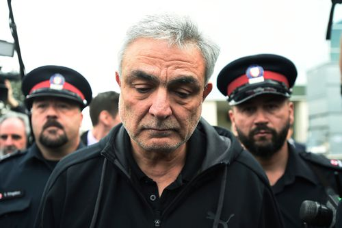 Minassian's father, Vahe, was guarded by police today as he attended his son's court appearance.