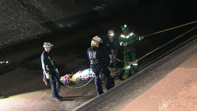 Man arrested after falling 5 metres into storm drain