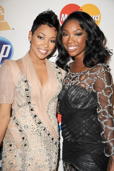 Brandi and Monica arrive at the 2011 Pre-GRAMMY Gala and Salute To Industry Icons Honoring David Geffen at The Beverly Hilton Hotel on February 12, 2011 in Beverly Hills, California.