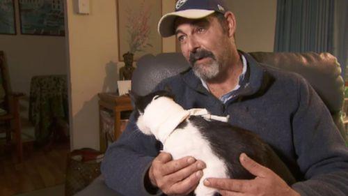 Grant Craigen with his beloved cat, Eddie. (9NEWS)