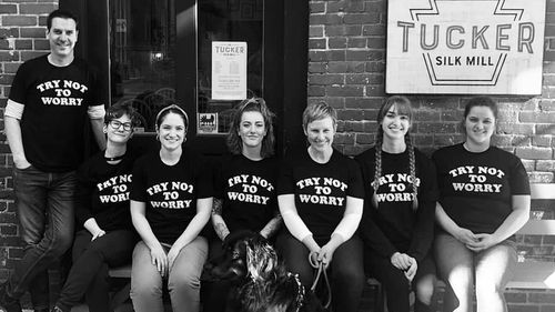 The Tucker crew on March 15 in their 'Try not to worry' t-shirts just days after the coronavirus gained momentum in America.