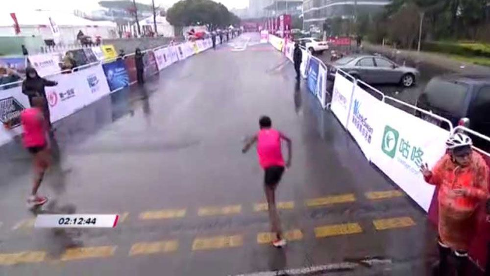 Wrong turn proves costly for leaders at Wuxi International Marathon in China