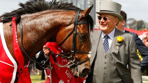 Owner Lloyd Williams celebrates in the mounting yard after winning race 7, the Emirates Melbourne Cup with his horse Rekindling in 2017