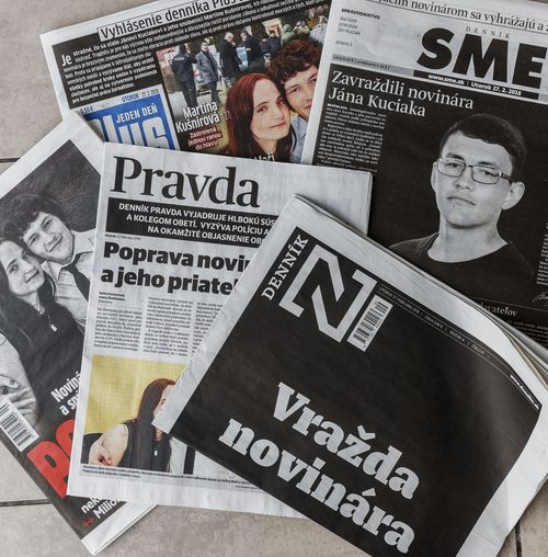 "Picture taken near the village of Velka Maca, Slovakia, Tuesday, Feb. 27, 2018, shows front pages of various Slovakian newspapers reflecting on murder of Slovak investigative journalist Jan Kuciak and his girlfriend Martina Kusnirova. Slovakia's top police officer Tibor Gaspar said the investigative reporter has been shot dead in his home in Velka Maca together with his girlfriend. Kuciak specialized in investigating tax evasion. The headline, down right, reads: ""Murder of Journalist."" (Michal Smrcok/News and Media Holding via AP)"