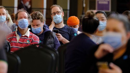 Photo of medical staff and patients at the Royal Exhibition Building Vaccination Hub on Saturday 31 July 2021.