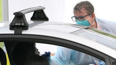 A person is tested at the Herston clinic in Brisbane.