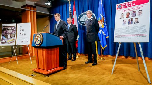 US Department of Justice assistant attorney general John Demers announces criminal charges against seven Russian Federation GRU intelligence officers in Washington, DC.