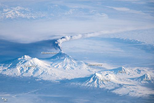 Astronauts on the International Space Station took this image of an eruption plume emanating from Klyuchevskoy, one of the many active volcanoes on the Kamchatka Peninsula. Bezymianny can be seen to the south.
