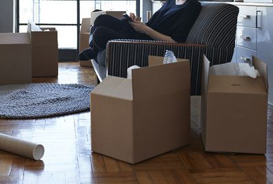 Woman packing up apartment ahead of move