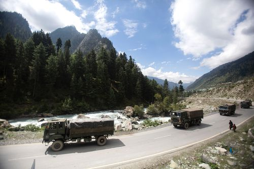 An Indian army convoy moves on the Srinagar-Ladakh highway at Gagangeer, northeast of Srinagar, Indian-controlled Kashmir.