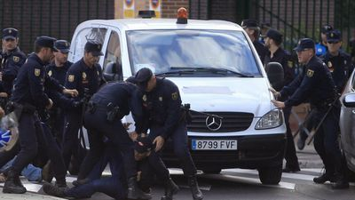 Police protect the van as it transports the dog to be put down. (AAP)