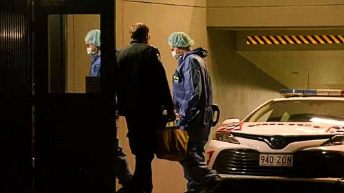 """Detective Inspector Trezise said that police had found the """"badly decomposed"""" body inside a """"large metal box"""" that had been sealed on the unit's veranda and might have been there for at least seven day."""