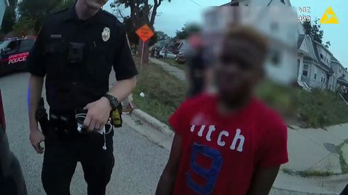 The video shows one of the boys being ordered onto his knees by police and weeping as he is handcuffed.