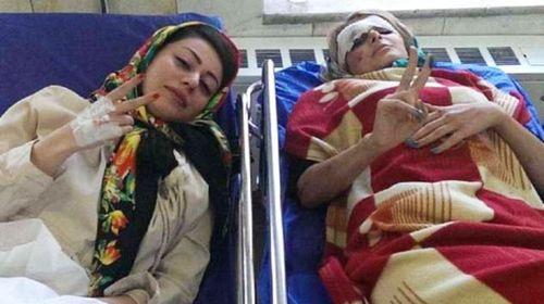 The two women pose for a photo in hospital after the crash.