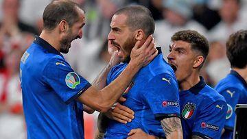 Leonardo Bonucci of Italy celebrates with Giorgio Chiellini and Giovanni Di Lorenzo after scoring their side's first goal