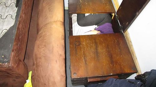 Border agents found 11 Chinese migrants hiding inside various pieces of furniture.