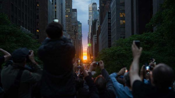 New Yorkers line the streets to capture Manhattanhenge. May 29, 2018