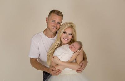 One happy family - Spencer, Heidi and new baby Gunner Stone.