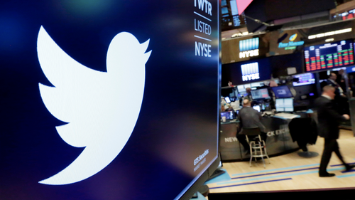 In this Feb. 8, 2018, file photo, the logo for Twitter is displayed above a trading post on the floor of the New York Stock Exchange. AP Photo/Richard Drew, File)