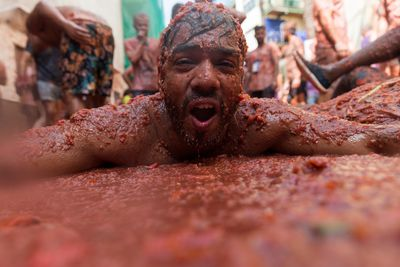 <p><strong>Thousands of revellers throw tomatoes at each other during the annual Tomatina festival in Spain. </strong></p>