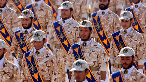 Iranian revolutionary guard soldiers march during the 2013 annual military parade marking the Iraqi invasion in 1980, which led to an eight-year-long war.