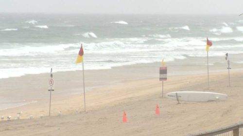 Surfers Paradise Beach is abandoned this morning with another 30mm of rain is forecast for southeast Queensland today. (9NEWS)