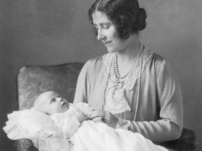 Elizabeth, the Queen Mother, holding her younger daughter Margaret Rose (1930 - 2002).