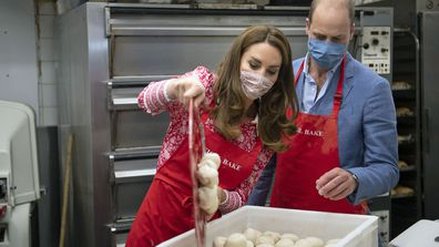 Britain's Prince William and Kate, Duchess of Cambridge make bagels during a visit to the Beigel Bake Brick Lane Bakery in London, Tuesday Sept. 15, 2020