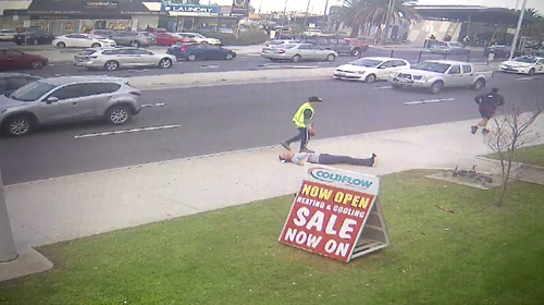 The man in the shorts appears to run from the scene after the alleged assault on Springvale Road.
