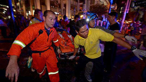 Emergency services rush the injured from the scene. (Getty Images)