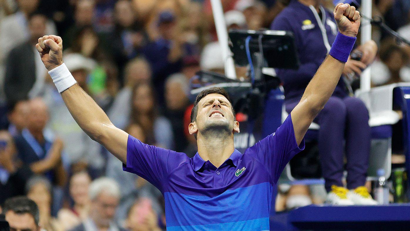 Novak Djokovic of Serbia celebrates winning match point to defeat Alexander Zverev of Germany