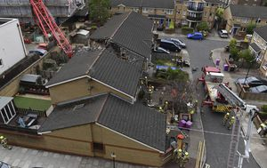 One person killed and others injured after crane collapses onto homes in London