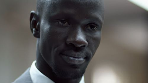 Mr Adut was conscripted into a rebel army and taken to Ethiopia, where he was shot in the back at the age of 12. (Western Sydney University)