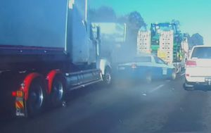 Queensland driver's dash camera captures two separate crashes in motorway pile-up