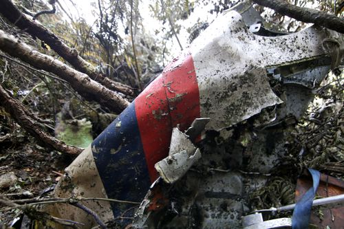 wreckage of a Sukhoi Super-jet 100 is seen at the crash site on Mount Salak , Bogor, West Java, Indonesia. Clearer weather finally allowed Indonesian helicopters to land Saturday and retrieve some remains of the 45 people aboard the Russian-made plane that crashed into the volcano during a demonstration flight. (AP Photo/Kusumadireza)