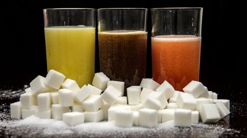Major beverage makers have agreed to cut sugar content in products across the industry. (AAP)
