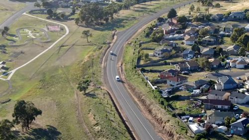 Drones are being used to find stolen vehicles and assist road safety. In this photo, a Tasmania Police drone tracks vehicles on a road.