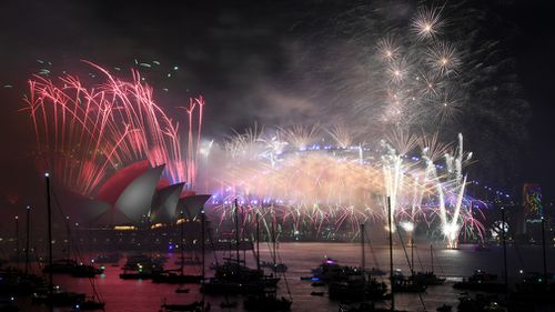 Fireworks explode over the Sydney Harbour during New Year's Eve celebrations in Sydney. (AAP)