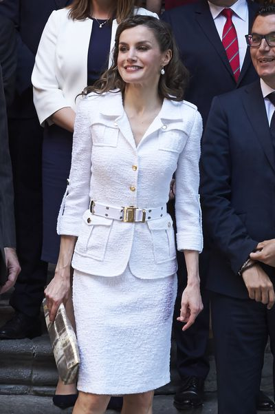 <p>The Spanish monarch complemented her white suit from Spanish designer Felipe Varela with a festival-inspired braid hairstyle in April 2017.</p>