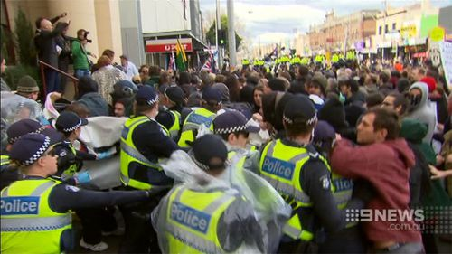 A number of times protesters from each side broke through the police barricade. (9NEWS)