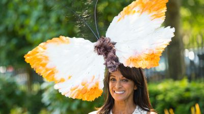 <p>Socialite Jackie St Claire shows off her butterfly piece on day one. (AAP) </p>