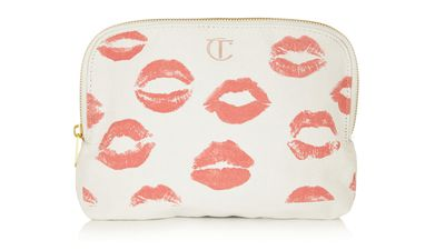 "<a href=""http://www.net-a-porter.com/au/en/product/555548"">Printed Cotton-Canvas Makeup Bag, $26.90, Charlotte Tilbury</a>"