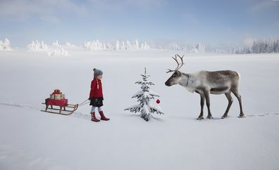 Child with reindeer