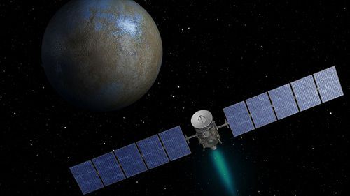 An artist's concept shows the Dawn spacecraft approaching the dwarf planet Ceres. (NASA/JPL-Caltech)