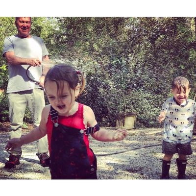 David Campbell's twins Billy and Betty cool off with Grandpa Jimmy Barnes