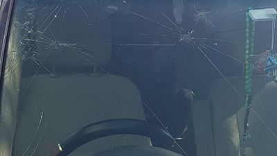 Another vehicle suffers windscreen damage as hail stones pelted down in the streets.