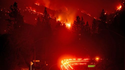 Hillsides were consumed by flames as wildfires spread through California.